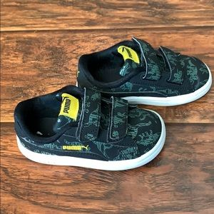 5T black Puma's with green dinosaurs.